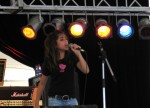 The youngest one onstage... only 12 years old... but she performs like a pro!