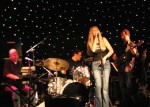 Kathy performs one of her songs with the CSN Band